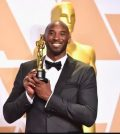 Kobe Bryant with an Oscar